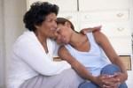 Grandmother comforting granddaughter