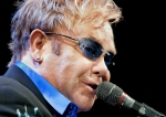 """Elton John performs """"Your Song"""" during a concert as part of the Shepard Symposium Friday night in Laramie at the Arena Auditorium. AAron Ontiveroz/staff"""