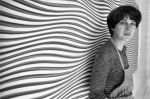 26th July 1979: Bridget Riley, British painter and leading figure in the Op Art movement, standing in front of one of her curving 'line' paintings at her studio. (Photo by Evening Standard/Getty Images)