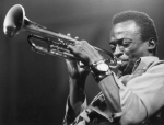 American jazz musician and composer Miles Davis (1926 - 1991) playing the trumpet. (Photo by Express Newspapers/Getty Images)